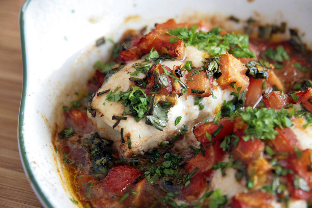 Baked cod and tomatoes